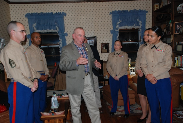 Retired Sgt. Maj. Harold G. Overstreet, center, the 12th Sergeant Major of the Marine Corps, shares a story with fellow Marines at the home of the 7th SMMC, retired Sgt. Maj. Henry H. Black.  Overstreet shared how he was on recruiting duty as a gunnery sergeant and petitioned Black for orders to the drill field, and two weeks later, his request was granted.