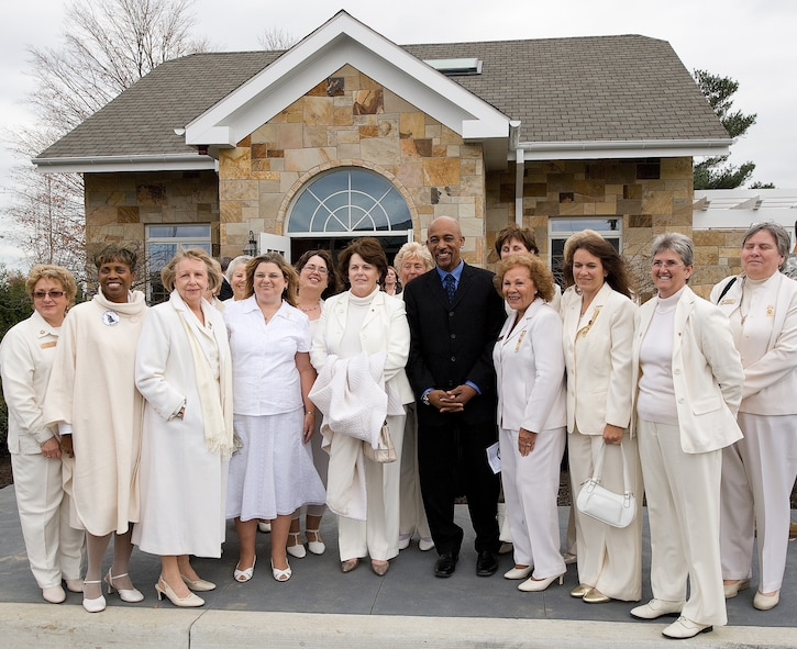 American Gold Star Mothers pose with Montel Williams in front of the Meditation Pavilion across from the new Fisher House for Families of the Fallen following a ribbon cutting ceremony Nov. 10, 2010. (U.S. Air Force photo/Jason Minto)