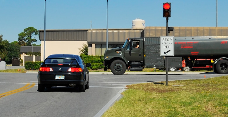 A driver stops at the traffic light by the Fuels Management building at the intersection of Tully and McClean Street. Drivers should be extra vigilant in this area because of the frequent passing of the 1st Special Operations Logistic Readiness Squadron fuel trucks. (Air Force photo by Senior Airman Sheila deVera) (RELEASED)