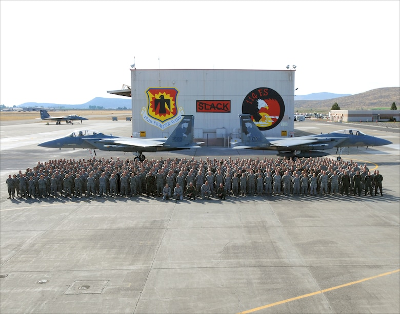 Members of the 173rd Fighter Wing pose for a group photo in front of two F-15 Eagles Oct. 17, 2010 at Kingsley Field, Klamath Falls, Ore. (U.S. Air Force photo by Tech. Sgt. Jennifer Shirar, RELEASED)