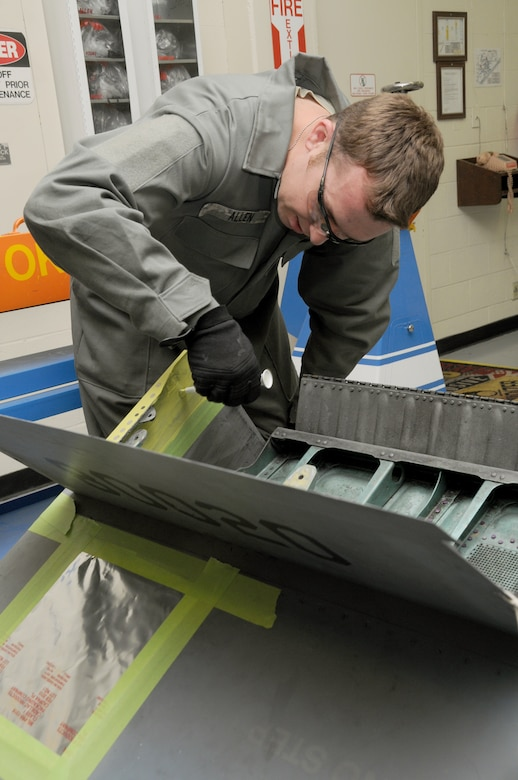 Staff Sergeant Paul Allen, 173rd Fighter Wing Structural Maintenance shop, lays down a coat of paint primer on an F-15 part at Kingsley Field, Ore., October 28, 2010  (U.S. Air Force photo by Senior Airman Bryan Nealy) Released