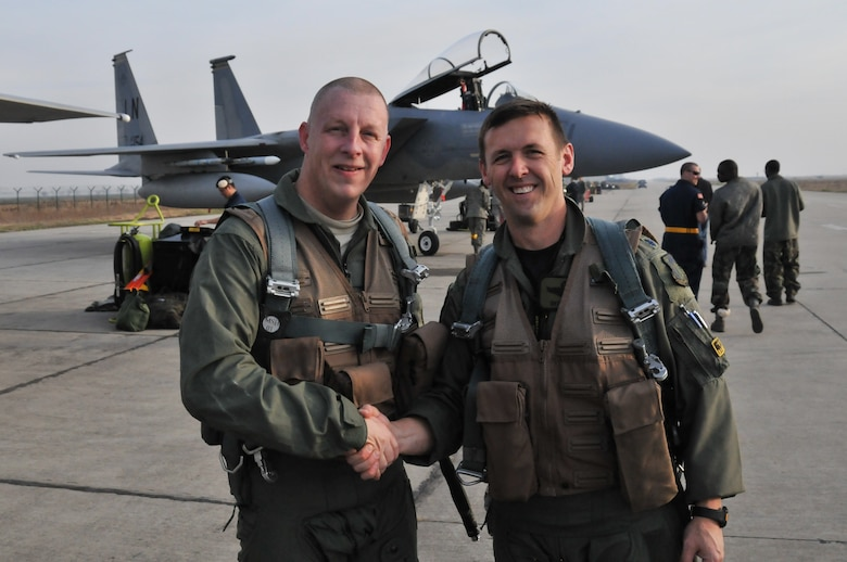 CAMPIA TURZII AIR BASE, Romania – Senior Master Sgt. Michael Seelhoff, 493rd Aircraft Maintenance Unit NCO in charge, shakes hands with Lt. Col. Skip Pribyl, 493rd Fighter Squadron commander, on the flightline here Nov. 2. Colonel Pribyl had just piloted the F-15C Eagle that carried Sergeant Seelhoff on the first incentive flight of his 25-year career. (U.S. Air Force photo/Senior Airman David Dobrydney)