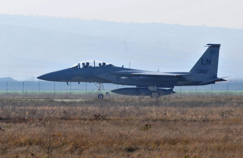 CAMPIA TURZII AIR BASE, Romania – An F-15C Eagle from the 493rd Fighter Squadron roars down the runway before taking off Nov. 2. In the rear seat is Senior Master Sgt. Michael Seelhoff, 493rd Aircraft Maintenance Unit NCO in charge, who took his first flight in the airframe he has worked on for 25 years. (U.S. Air Force photo/Senior Airman David Dobrydney)