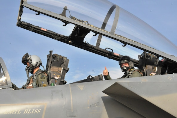 CAMPIA TURZII AIR BASE, Romania – Senior Master Sgt. Michael Seelhoff, 493rd Aircraft Maintenance Unit NCO in charge, gives a thumbs-up before taking off in an F-15C Eagle on the first incentive flight of his 25-year career. Piloting the aircraft is Lt. Col. Skip Pribyl, 493rd Fighter Squadron commander. (U.S. Air Force photo/Senior Airman David Dobrydney)