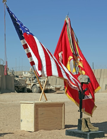A strong breeze blows through a battlefield cross display honoring Lance Cpl. Terry E. Honeycutt Jr., a machine-gunner with Fox Company, 2nd Battalion, 9th Marine Regiment, during a memorial service at a Marine Corps Base in Helmand Province, Afghanistan, Nov. 11. Honeycutt gave the ultimate sacrifice, Oct. 27, while conducting combat operations in Northern Marjah.