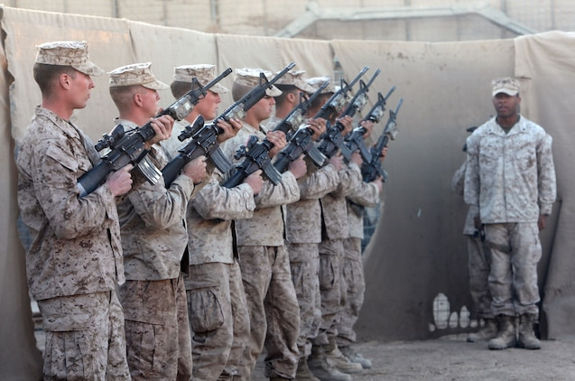 A rifle detail with Echo Company, 2nd Battalion, 6th Marine Regiment renders a final, honorable farewell to 1st Lt. James Zimmerman, formerly the commander of the company's 3rd Platoon, during his memorial service at Patrol Base Shanfield, Helmand province, Afghanistan, Nov. 11. Zimmerman was from Aroostock, Maine.