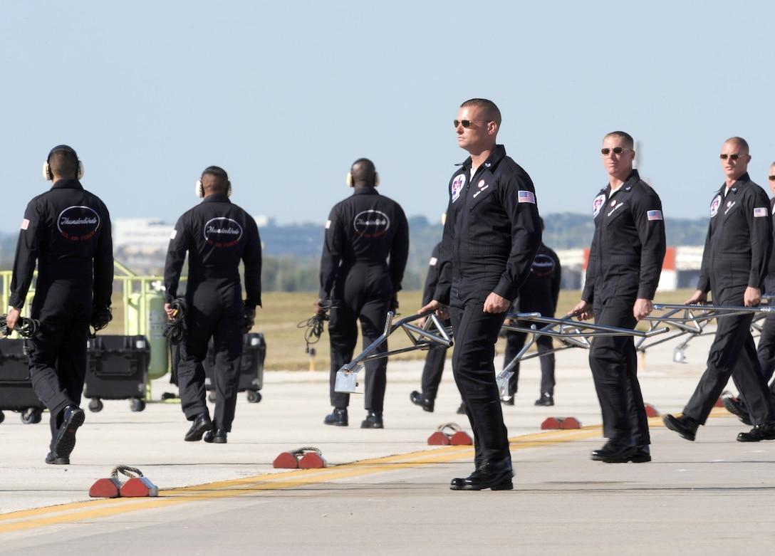 The 2010 Thunderbird crew chiefs perform their ground show during AirFest 2010 air show Nov. 7, 2010, at Lackland Air Force Base, Texas. (U.S. Air Force photo/Staff Sgt. Larry E. Reid Jr.)