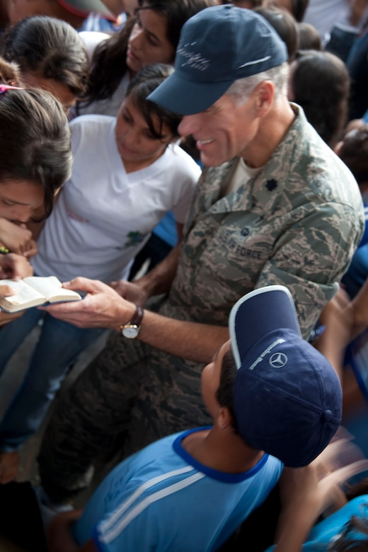 Chaplain (Lt. Col.) Ron Prosise, 140th Wing chaplain, interacts with a local student. A group of more than 15 airmen visited the local school of Eliah Maia do Rego, Natal Brazil, building community relations during CRUZEX V. During the visit the airmen interacted with the students on an informal basis; distributed small gifts and took group pictures. CRUZEX V, or Cruzeiro Do Sul (Southern Cross), is a multi-national combined exercise involving the Air Forces of Argentina, Brazil, Chile, France and Uruguay, , and observers from numerous other countries with more than 82 aircraft and almost 3,000 Airmen involved. (U.S. Air Force photo/Staff Sgt. Michael Matkin)