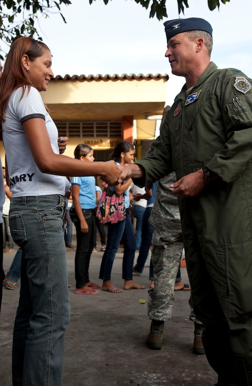 Col. Edward Kostelnik; 12th Air Force (Air Forces Southern) Director of Operations. presents a military coin to a student of Eliah Maia do Rego; Natal Brazil. A group of more than 15 airmen visited the local school building community relations during CRUZEX V. During the visit the airmen interacted with the students on an informal basis; distributed small gifts and took group pictures. CRUZEX V, or Cruzeiro Do Sul (Southern Cross), is a multi-national combined exercise involving the Air Forces of Argentina, Brazil, Chile, France and Uruguay, , and observers from numerous other countries with more than 82 aircraft and almost 3,000 Airmen involved. (U.S. Air Force photo/Staff Sgt. Michael Matkin)