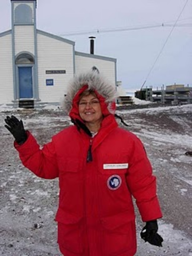 "U.S. Air Force Chaplain (Major) Laura Adelia poses in front of Chapel of the Snow, McMurdo Station, Antarctica, where she became the first female chaplain on station during her 60-day tour Oct. 3, 2010. She will be providing spiritual support to the various military personnel assigned to ""Operation Deep Freeze,""  (courtesy photo)"