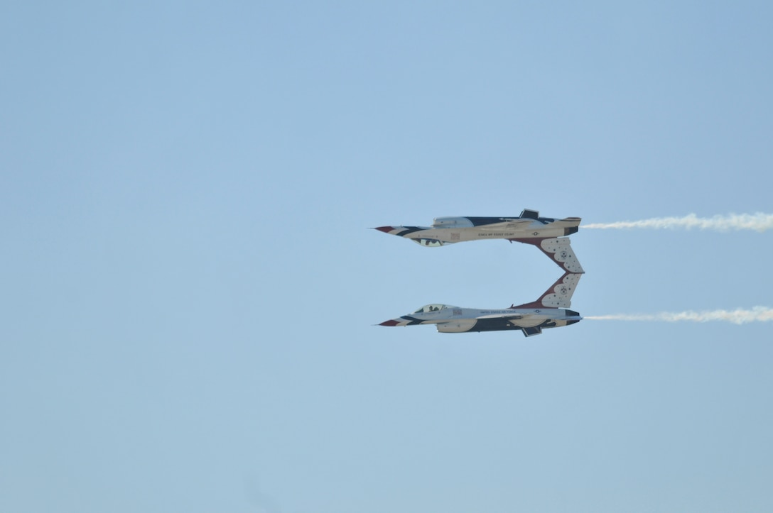 The U.S. Air Force air demonstration team, the Thunderbirds, perform precision aerial maneuvers Nov. 6, 2010, during AirFest 2010 at Lackland Air Force Base, Texas.  (U.S. Air Force photo/Jim Pritchett)