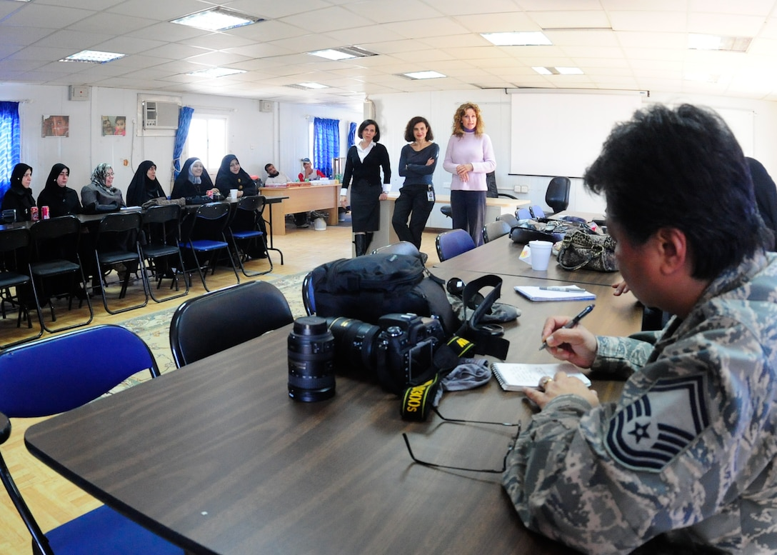 U.S. Air force Senior Master Sgt. Elizabeth Gilbert, 407th Air Expeditionary Wing, public affairs, participates in an all women journalist seminar held at the Itallian Proviscial Reconstruction Team camp to enhance the journalistic skills of Iraqi women prior to their national election Jan. 26, 2010. (U.S. Air Force photo by Master Sgt. Darrell Habisch/released)