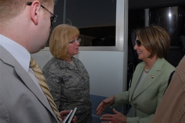 Carla Bove, 448th Supply Chain Management Wing chief of Protocol, left, meets with Nancy Pelosi, speaker of the United States House of Representatives, in Qatar before the women board a bus to visit another site on the compound. (Courtesy photo)