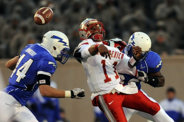 New Mexico quarterback Stump Godfrey is hit by Air Force's Bradley Connor during the Air Force-New Mexico game at Falcon Stadium Nov. 13, 2010. The Falcons defeated the Lobos, 48-23, in their final home game of the season. The Falcons, 7-4 overall and 4-3 in the Mountain West Conference, close out their regular season against UNLV Nov. 18. (Air Force photo/Johnny Wilson)