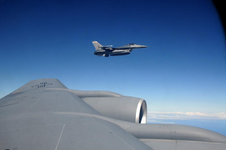 A U.S. Air Force F-16 Fighting Falcon from the 140th Fighter Wing, Buckley, Colo.,  flies off the wing  of a 161st Air Refueling Wing  KC-135 Stratotanker during a CRUZEX exercise on November 12, 2010 over Brazil. Both wings are participating in CRUZEX V, or Cruzeiro Do Sul (Southern Cross).  CRUZEX  is a multi-national combined exercise involving the Air Forces of Argentina, Brazil, Chile, France and Uruguay, and observers from numerous other countries with more than 82 aircraft and almost 3,000 Airmen involved.  U.S. Air Force Photo by Master Sgt. Kelly M. Deitloff
