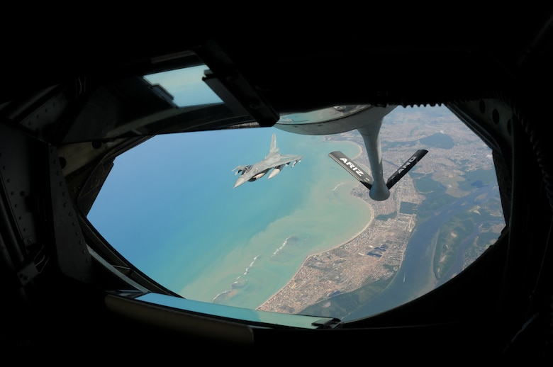 A U.S. Air Force F-16 Fighting Falcon from the 140th Fighter Wing, Buckley, Colo., detaches from a KC-135 Stratotanker from the 161st Air Refueling Wing, Phoenix, Ariz., after refueling over Brazil in support of CRUZEX, November 12, 2010,. Both wings are participating CRUZEX V, or Cruzeiro Do Sul (Southern Cross).  CRUZEX is a multi-national combined exercise involving the Air Forces of Argentina, Brazil, Chile, France and Uruguay, and observers from numerous other countries with more than 82 aircraft and almost 3,000 Airmen involved.  U.S. Air Force Photo by Master Sgt. Kelly M. Deitloff
