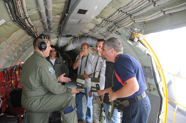 Master Sgt. Ken Daughenbaugh, a boom operator for the 161st Air Refueling Wing, Phoenix Ariz.,  conducts a safety briefing to a local media crew before a refueling mission on November 12, 2010. The 161st ARW is participating in CRUZEX V, or Cruzeiro Do Sul (Southern Cross).  CRUZEX  is a multi-national combined exercise involving the Air Forces of Argentina, Brazil, Chile, France and Uruguay, and observers from numerous other countries with more than 82 aircraft and almost 3,000 Airmen involved. U.S. Air Force Photo by Master Sgt. Kelly Deitloff