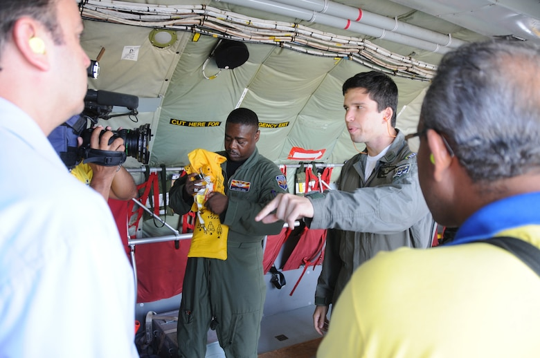 RECIFE, Brazil ? Master Sgt Vince Jones,  a boom operator for the 161st Air Refueling Wing, Phoenix Ariz., and LT Ortiz, a pilot for the Brazilian Air Force, give a safety briefing to a local media crew before a refueling mission on November 9, 2010. The 161st ARW is participating in CRUZEX V, or Cruzeiro Do Sul (Southern Cross).  CRUZEX  is a multi-national combined exercise involving the Air Forces of Argentina, Brazil, Chile, France and Uruguay, and observers from numerous other countries with more than 82 aircraft and almost 3,000 Airmen involved. U.S. Air Force Photo by Master Sgt. Kelly M. Deitloff