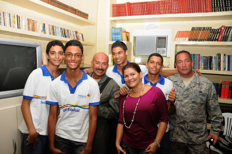 master Sgt. Johnny Narro and Technical Sgt. Guillermo Celaya from 161st Air Refueling Wing, Phoenix, Ariz., pose with students and their teacher Giselda Vila Nova from Escola Santos Dumont School on November 11, 2010, in Recife, Brazil . The 161st ARW is participating in CRUZEX V, or Cruzeiro Do Sul (Southern Cross).  CRUZEX  is a multi-national combined exercise involving the Air Forces of Argentina, Brazil, Chile, France and Uruguay, and observers from numerous other countries with more than 82 aircraft and almost 3,000 Airmen involved.  U.S. Air Force Photo by Master Sgt. Kelly M. Deitloff