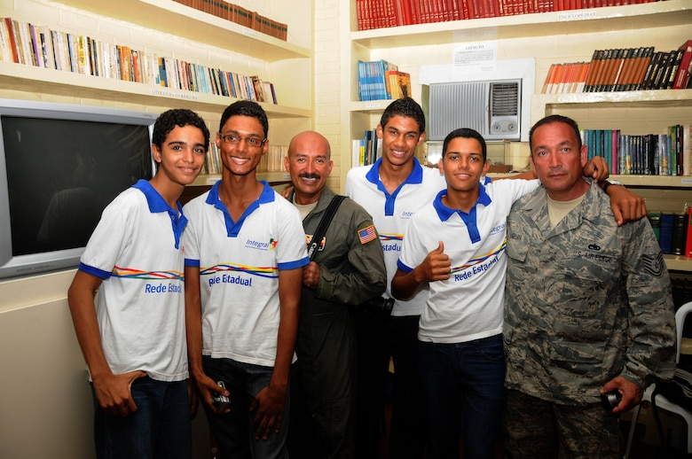 Master Sgt. Johnny Narro and Technical Sgt. Guillermo Celaya from 161st Air Refueling Wing, Phoenix, Ariz., pose with students from Escola Santos Dumont School on November 11, 2010, in Recife, Brazil . The 161st ARW is participating in CRUZEX V, or Cruzeiro Do Sul (Southern Cross).  CRUZEX  is a multi-national combined exercise involving the Air Forces of Argentina, Brazil, Chile, France and Uruguay, and observers from numerous other countries with more than 82 aircraft and almost 3,000 Airmen involved.  U.S. Air Force Photo by Master Sgt. Kelly M. Deitloff