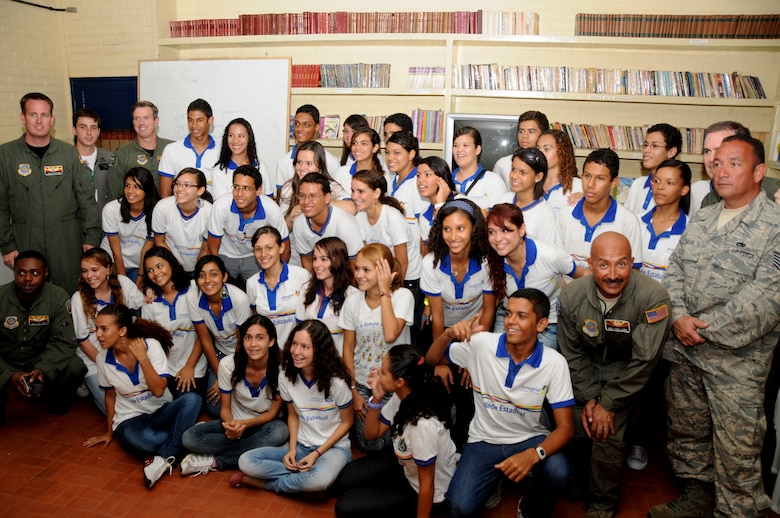 Members of the 161St Air Refueling Wing, Phoenix, Ariz.,pose with students from Escola Santos Dumont School on November 11, 2010, in Recife, Brazil . The 161st ARW is participating in CRUZEX V, or Cruzeiro Do Sul (Southern Cross).  CRUZEX  is a multi-national combined exercise involving the Air Forces of Argentina, Brazil, Chile, France and Uruguay, and observers from numerous other countries with more than 82 aircraft and almost 3,000 Airmen involved.  U.S. Air Force Photo by Master Sgt. Kelly M. Deitloff
