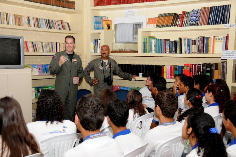 Major Quinn Casey and Master Sgt. Johnny Narro from the 161st Air Refueling Wing, Phoenix, Ariz., talk with students from Escola Santos Dumont School on November 11, 2010, in Recife, Brazil . The 161st ARW is participating in CRUZEX V, or Cruzeiro Do Sul (Southern Cross).  CRUZEX  is a multi-national combined exercise involving the Air Forces of Argentina, Brazil, Chile, France and Uruguay, and observers from numerous other countries with more than 82 aircraft and almost 3,000 Airmen involved.  U.S. Air Force Photo by Master Sgt. Kelly M. Deitloff