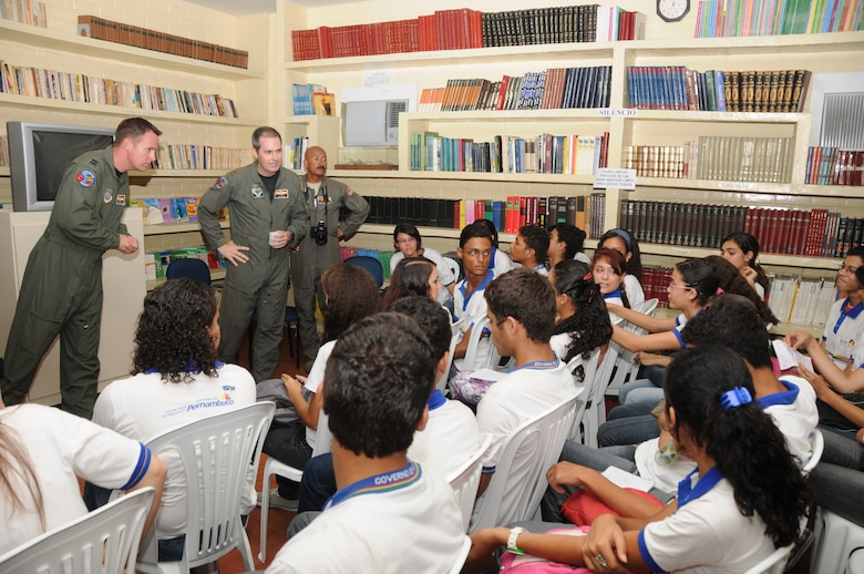 Captain Travis Grantham, Major Quinn Casey and Master Sgt. Johnny Narro from the 161st Air Refueling Wing, Phoenix, Ariz., talk with students from Escola Santos Dumont School on November 11, 2010, in Recife, Brazil . The 161st ARW is participating in CRUZEX V, or Cruzeiro Do Sul (Southern Cross).  CRUZEX  is a multi-national combined exercise involving the Air Forces of Argentina, Brazil, Chile, France and Uruguay, and observers from numerous other countries with more than 82 aircraft and almost 3,000 Airmen involved.  U.S. Air Force Photo by Master Sgt. Kelly M. Deitloff