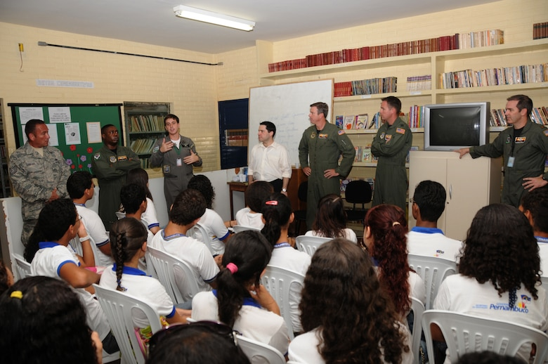 LT Spiller of the Brazilian Air Force and members of the 161st Air Refueling Wing, Phoenix, Ariz., talk with students from Escola Santos Dumont School on November 11, 2010, in Recife, Brazil . The 161st ARW is participating in CRUZEX V, or Cruzeiro Do Sul (Southern Cross).  CRUZEX  is a multi-national combined exercise involving the Air Forces of Argentina, Brazil, Chile, France and Uruguay, and observers from numerous other countries with more than 82 aircraft and almost 3,000 Airmen involved.  U.S. Air Force Photo by Master Sgt. Kelly M. Deitloff