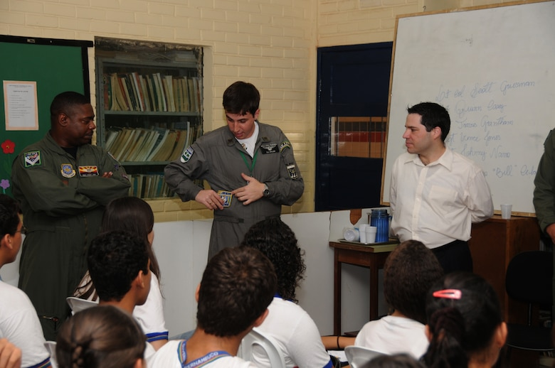 Master Sgt. Vince Jones of the 161st Air Refueling Wing, Phoenix, Ariz., LT Spiller of the Brazilian Air Force and Juan Cruz, Vice Consul,  talk with students from Escola Santos Dumont School on November 11, 2010, in Recife, Brazil . The 161st ARW is participating in CRUZEX V, or Cruzeiro Do Sul (Southern Cross).  CRUZEX  is a multi-national combined exercise involving the Air Forces of Argentina, Brazil, Chile, France and Uruguay, and observers from numerous other countries with more than 82 aircraft and almost 3,000 Airmen involved.  U.S. Air Force Photo by Master Sgt. Kelly M. Deitloff