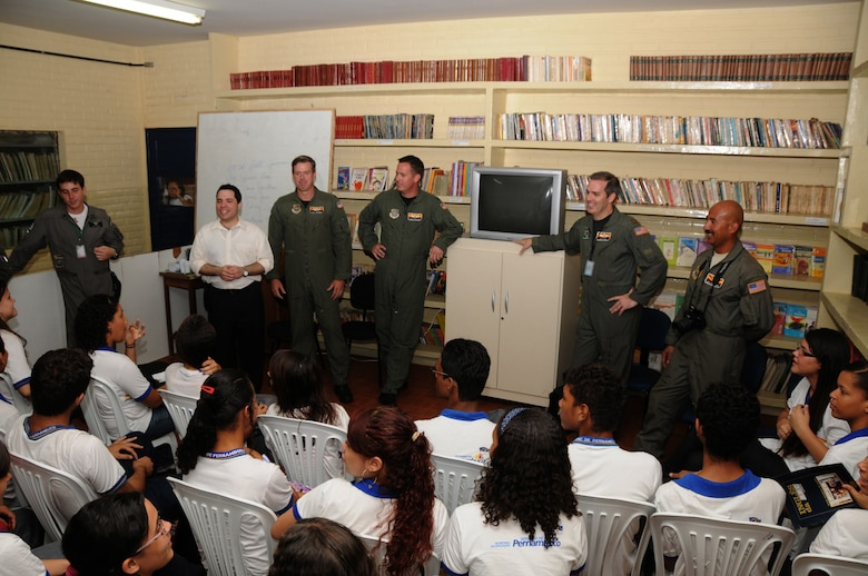 Members from the 161st Air Refueling Wing, Phoenix, Ariz., talk with students from Escola Santos Dumont School on November 11, 2010, in Recife, Brazil . The 161st ARW is participating in CRUZEX V, or Cruzeiro Do Sul (Southern Cross).  CRUZEX  is a multi-national combined exercise involving the Air Forces of Argentina, Brazil, Chile, France and Uruguay, and observers from numerous other countries with more than 82 aircraft and almost 3,000 Airmen involved.  U.S. Air Force Photo by Master Sgt. Kelly M. Deitloff