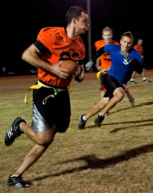 Tim Ager, Air Force Research Lab, sprints down field during the base intramural championship game, Nov. 10.  AFRL defeated the 53rd (14-12) in the second of two games to win back-to-back base titles.  The 53rd team gave AFRL its only loss of the season, (20-19) earlier in the evening, forcing a winner-take-all game in the double-elimination tournament.  (U.S. Air Force photo/ Samuel King Jr.)