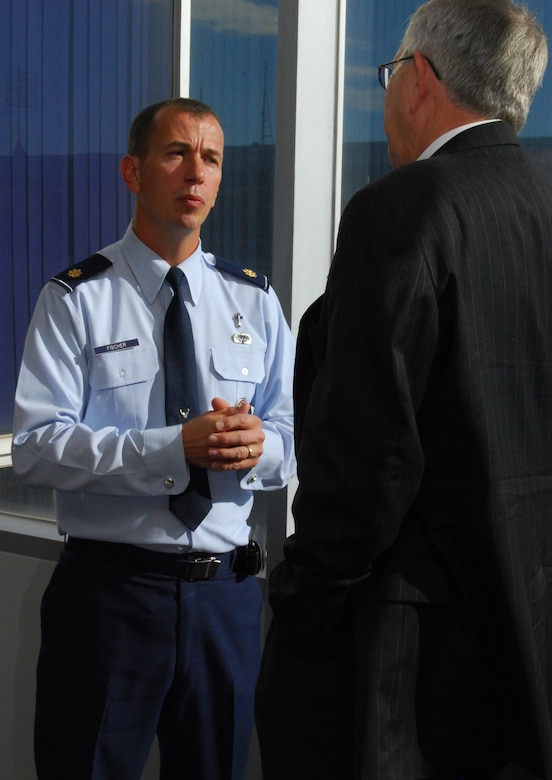 Chaplain (Maj.) Peter Fischer and the Right Reverend James Magness talk outside the Dean of Faculty Conference Room at the Air Force Academy during a break at the Religious Respect Conference at the Academy Nov. 16, 2010. Topics at the conference included balancing freedom of religious expression with the Constitution's prohibition against establishing or endorsing religion. Chaplain Fischer is the Academy's senior protestant chaplain. Reverend Magness is the bishop suffragan for federal ministries for the Office of Federal Ministries of the Episcopal Church. (U.S. Air Force photo/Staff Sgt. Don Branum)