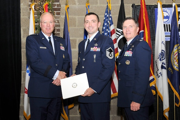 KNOXVILLE, Tenn. - Master Sgt. Keith M. Cavanaugh, center, a senior instructor at the Paul H. Lankford Professional Military Education Center at McGhee Tyson ANGB, is recognized by the East Tennessee Military Affairs Council for outstanding service during the 28th Annual Veteran's Day Awards and Recognition luncheon at the Foundry on the World's Fair site here, Nov. 11, 2010.  Also pictured are (L) Gen. Craig R. McKinley, Chief, National Guard Bureau, and (R) Col. Richard B. Howard, commander of The I.G. Brown Air National Training and Education Center.  (U.S. Air Force photo by Master Sgt. Kurt Skoglund/Released)