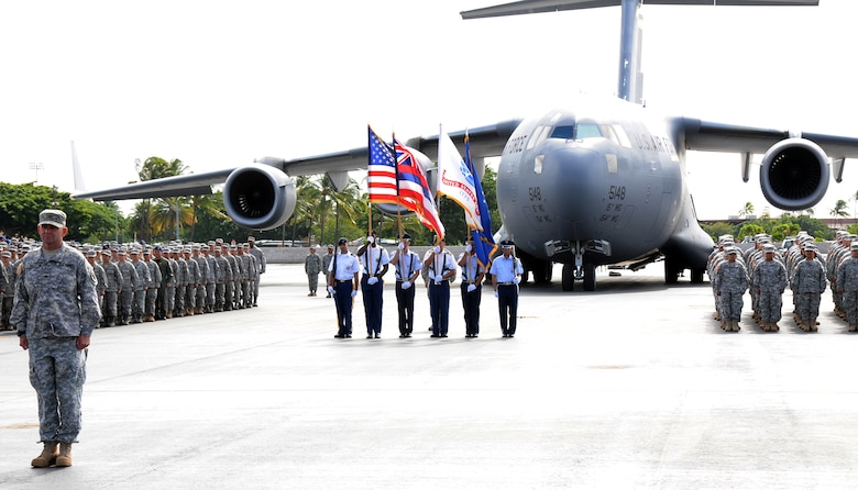 Members of the Hawaii Air and Army National Guard along with the Color Guard stand in formation in front of the C-17 Globemaster III during the retirement ceremony for Maj. Gen. Robert G.F. Lee, Hawaii adjutant general, on Joint Base Pearl Harbor-Hickam, Nov. 6.  Maj. Gen. Lee performed his final troop inspection as the adjutant general as part of the retirement ceremony. (U.S. Air Force photo/Tech. Sgt. Betty J. Squatrito-Martin)