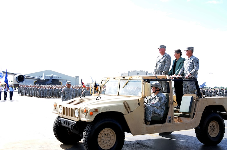 Gen. Craig T. McKinley, National Guard Bureau chief, Hawaii Gov. Linda Lingle, and Maj. Gen. Robert G. F. Lee, Hawaii Adjutant General make their way to review the troops of the Hawaii Army and Air National Guard during Maj. Gen. Lee's farewell ceremony on Joint Base Pearl Harbor-Hickam, Nov 6. Gov. Lingle and Maj. Gen. Lee performed their last review of the troops in the Hawaii Air and Army National Guard . Both Gov. Lingle and Maj. Gen. Lee will leave office after eight years of leading the state of Hawaii. (U.S. Air Force photo/Tech. Sgt. Betty J. Squatrito-Martin)