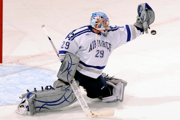 Air Force goalie Jason Torf blocks a shot on goal during the Falcons' match against No. 3 Yale at the Cadet Ice Arena Nov. 14, 2010. Torf, a native of Hermosa Beach, Calif., was named an Atlantic Hockey Association rookie of the week after making 34 saves in the Falcons' 4-3 victory. (U.S. Air Force photo/Mike Kaplan)