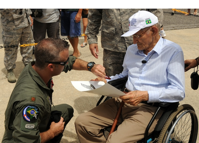 Emil Anthony Petr visits with Maj. Jeremiah Tucker, 140th Wing F-16 Fighting Falcon pilot, during an open house at Natal Air Base, Brazil in conjunction with CRUZEX V. Mr. Petr is a World War II veteran who currently lives in Natal. CRUZEX, or Cruzeiro Do Sul (Southern Cross), is a multi-national combined exercise involving the Air Forces of Argentina, Brazil, Chile, France and Uruguay, and observers from numerous other countries with more than 82 aircraft and almost 3,000 Airmen involved. (U.S. Air Force photo/Staff Sgt. Michael Matkin)