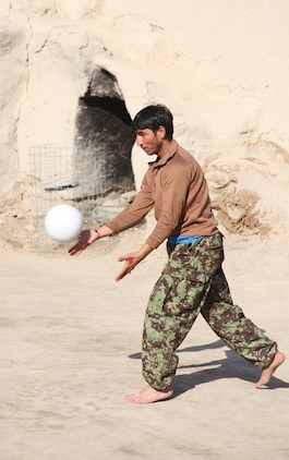 An Afghan National Army soldier serves the volleyball during a friendly match with the Marines of India Company, 3rd Battalion, 5th Marine Regiment, at ANA Post Nabi Nov. 16, 2010. The Afghan National Army won all three games played.