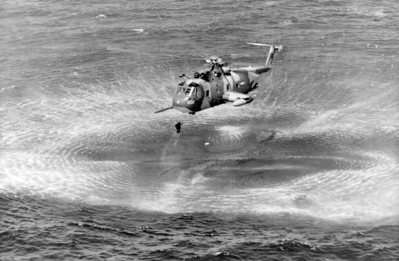 A USAF HH-3E rescues a pilot from the water off the coast of Vietnam. (U.S. Air Force photo)