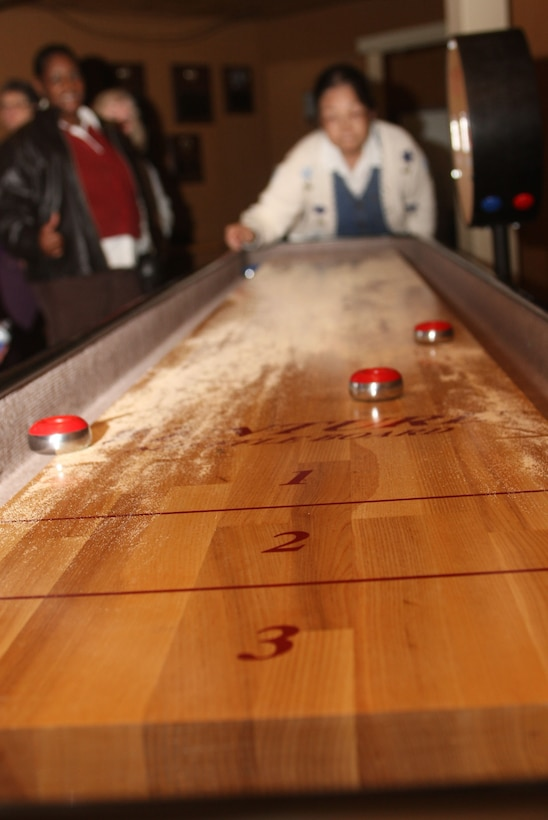 Shuffleboard was one of the team events during the first Dobbins Air Reserve Base Team Day held Nov 17. (U.S. Air Force Photo/Don Peek)