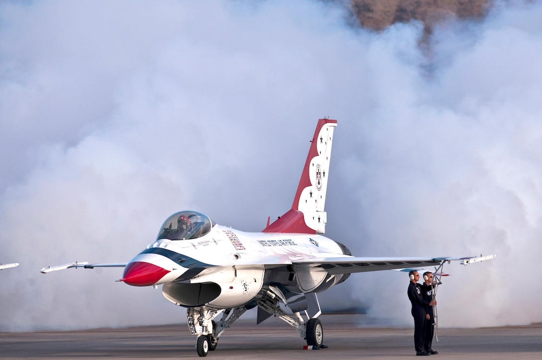 Maj. Rick Goodman, lead solo with the Air Force Air Demonstration Squadron, the Thunderbirds, releases smoke and as he prepares to exit his F-16 Fighting Falcon at the 2010 air show at Nellis Air Force Base, Nev., Nov. 14, 2010. The open house is the final air show of the year for the squadron. (U.S. Air Force photo/Tech. Sgt. Michael R. Holzworth)
