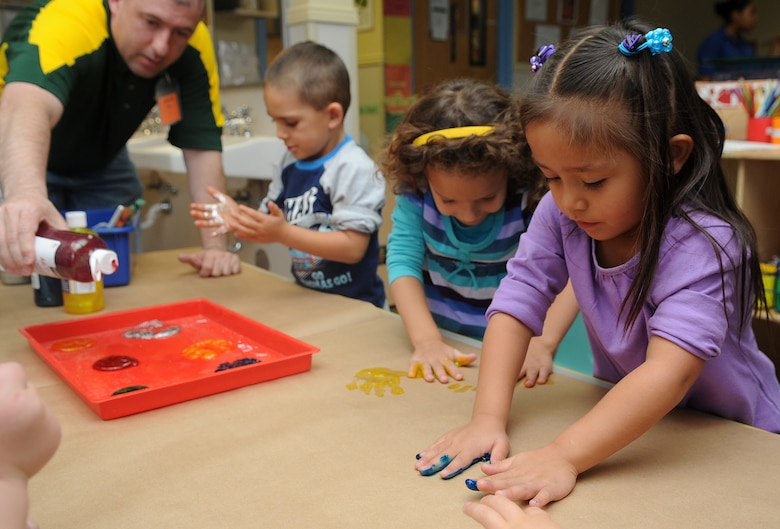Buckley Air Force Base, Colo.- Children from the Child Development Center finger paint with volunteers from Team Buckley honoring Native American Heritage month. ( U.S. Air Force Photo by Airman First Class Marcy Glass )