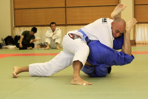 Chief Warrant Officer Sergio Esquivel, bluebelt in Jujitsu and second degree blackbelt in the Marine Corps Martial Arts program, competes against Fujioka Yu, blue-belt competitor, during the 8th Annual West Japan Jujitsu Championship tournament at the Minami Ward Sports Center in Hiroshima Sunday. The Minami Ward Sports Center in Hiroshima hosts many martial arts competitions, which are open to all competitive skill levels and techniques within the rules of the sport.