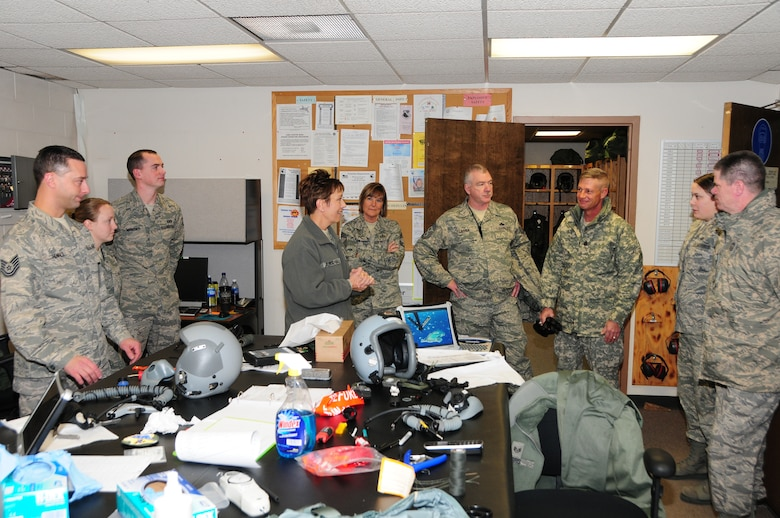 National Guard Bureau Command Chief Master Sgt. Denise Jelinski-Hall talks with members of the Life Support shop after arriving at the 148th Fighter Wing on Nov. 20, 2010 in Duluth, Minn.  Chief Master Sgt Denise Jelinski Hall came to the 148th FW to host an Airmens Call where she covered subjects such as suicide prevention and the importance family, friends and civilian employers have to the Naional Guard mission.  (U.S. Air Force photo by Staff Sgt. Donald Acton)