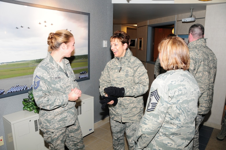 National Guard Bureau Command Chief Master Sgt. Denise Jelinski-Hall shares a laugh during a discussion with Master Sgt. Jennifer Brown and Chief Master Sgt. Marcia Dumancas after arriving at the 148th Fighter Wing on Nov. 20, 2010 in Duluth, Minn.  Chief Master Sgt. Denise Jelinski Hall came to the 148th FW to host an Airmens Call where she covered subjects such as suicide prevention and the importance family, friends and civilian employers have to the Naional Guard mission.  (U.S. Air Force photo by Staff Sgt. Donald Acton)