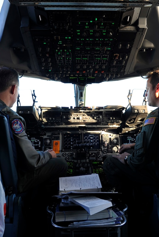 Maj Josh Glenn (Left), 183rd Airlift Squadron, Maj John Wilkinson (Right),183rd Airlift Squadron, performs an flight check before take off from Buckley AFB, Colo, Nov. 22, 2010. Generous donations came from organizations such as the National Ski Areas Association, Hope Seeds, the U.S. Olympic Committee.(U.S. Air Force photo by Airman 1st Class Paul Labbe.)