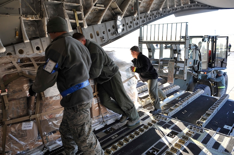 Members of the 183rd Airlift Squadron loads pallets into a C-17 Globe Master III at Buckley, AFB, Co, Nov. 22, 2010.The project was launched last year by CAP Worldwide the lead coordinator of the humanitarian initiative.(U.S. Air Force photo by Airman 1st Class Paul Labbe.)