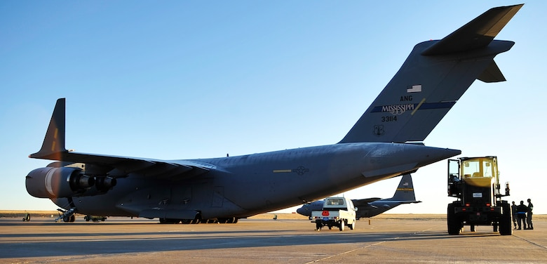 A C-17 Globe Master III sits on the flight line at Buckley AFB Colo., before being loaded with around 88 pallets of supplies for approximately 10,000 people, Nov. 22, 2010.Weighing in at nearly 100,000 pounds, this shipment of donated supplies will soon make its way from Colorado to Kabul.(U.S. Air Force photo by Airman 1st Class Paul Labbe.)