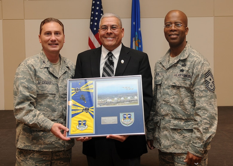 Buckley Air Force Base, Colo.-  Colonel Clinton Crosier and Chief Master Sgt. Robert Ellis present Chief Master Sgt (Ret.) Bob Vasquez with an honorary plaque. CMSgt Vasquez was guest speaker for Buckley's Native American Heritage celebration. ( U.S. Air Force Photo by Airman 1st Class Marcy Glass )