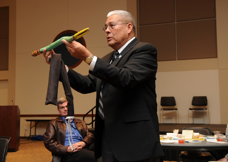 """Buckley Air Force Base, Colo.-  Guest speaker, Chief Master Sergeant (Ret.) Bob Vasquez holds up a """"talking stick"""" often used as a remedy to prevent interruptions during social gatherings.  ( U.S. Air Force Photo by Airman 1st Class Marcy Glass )"""